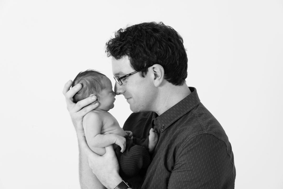 newborn photographer slider baby boy and dad