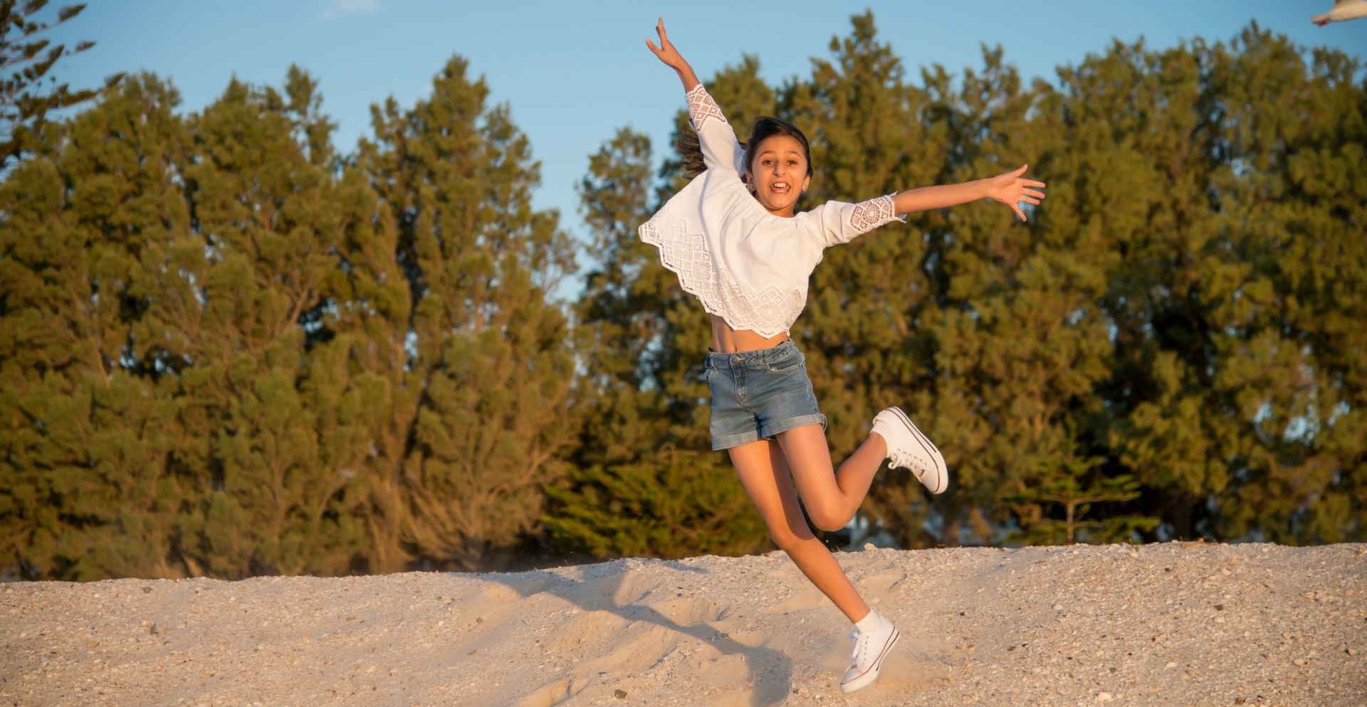 A photo of a girl jumping