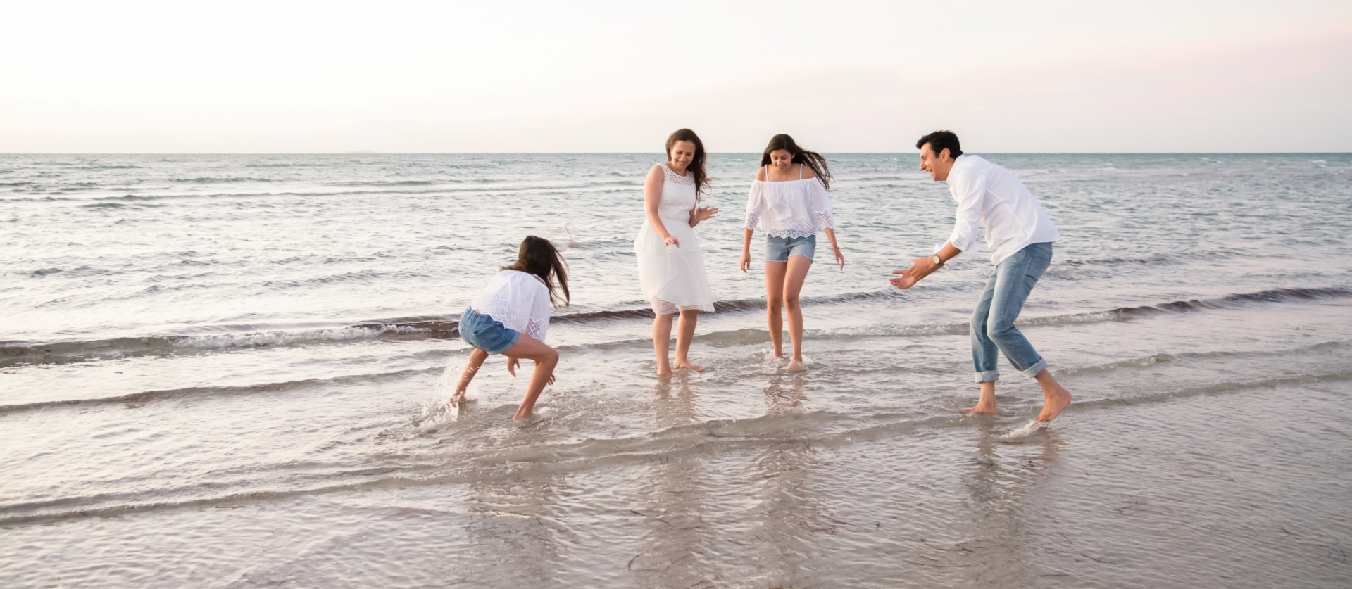 A photo of a family playing on the beach