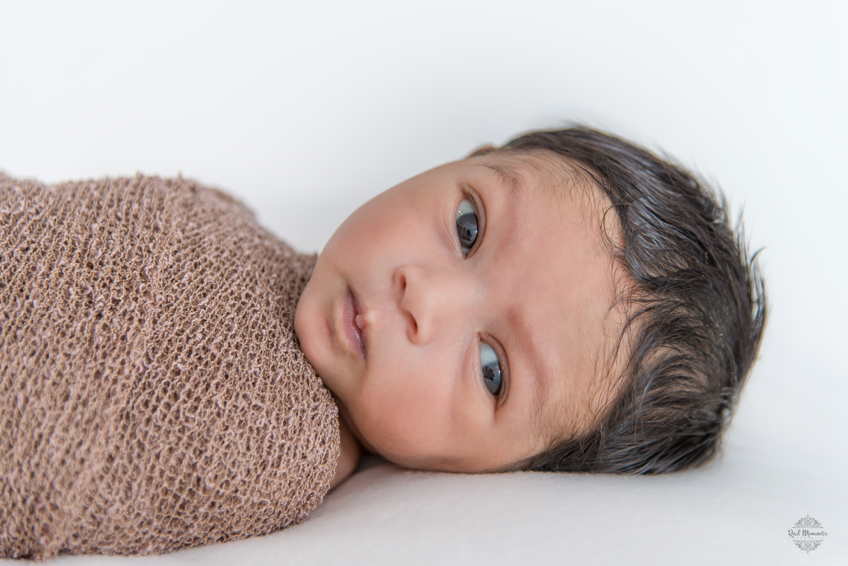 A newborn photography portrait of Baby Achu