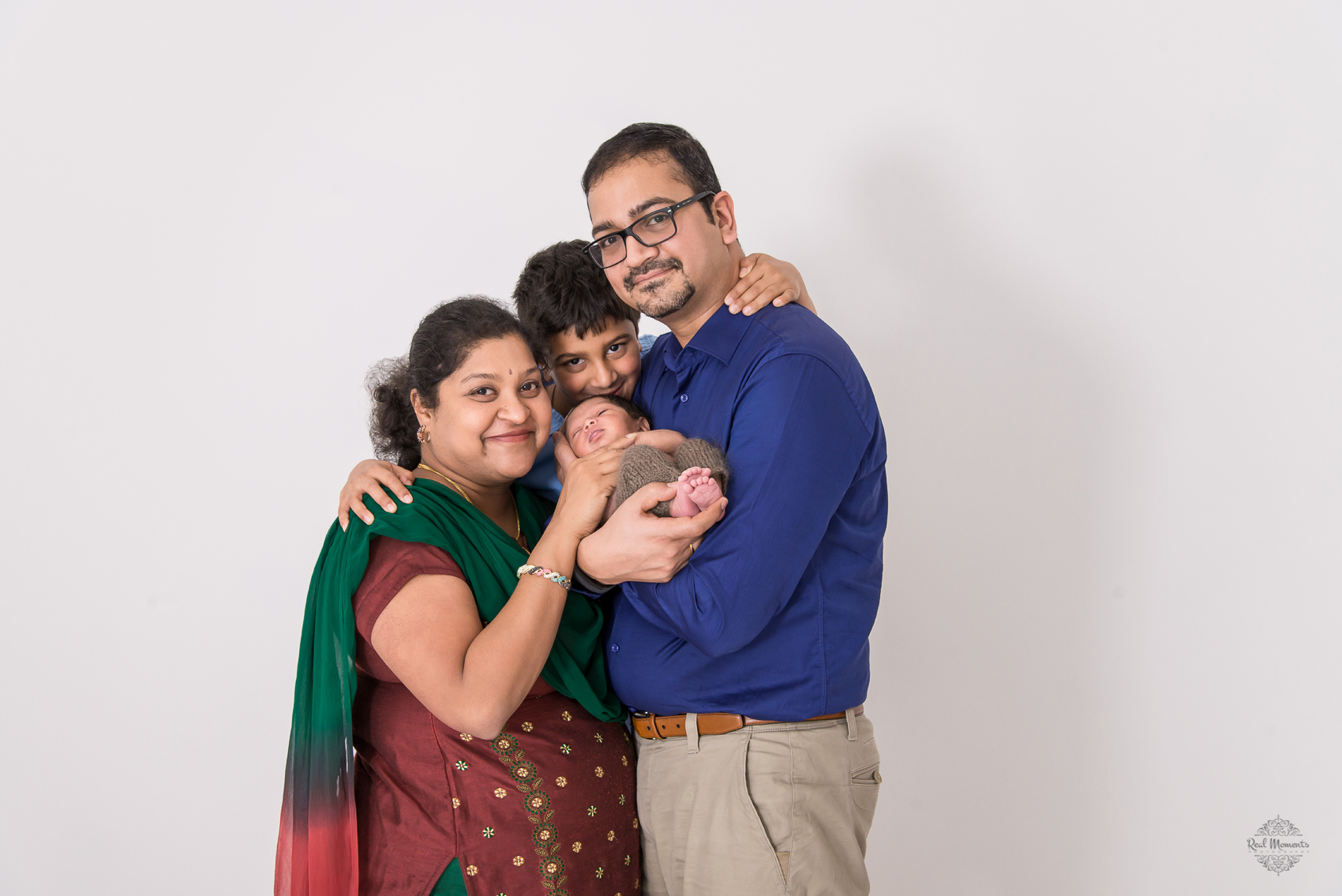 A photo of Baby Achu and his family