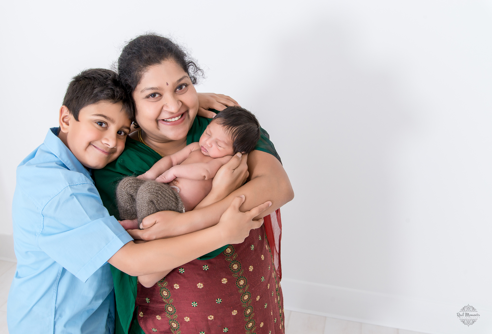 A photo of Baby Achu and his mother and brother