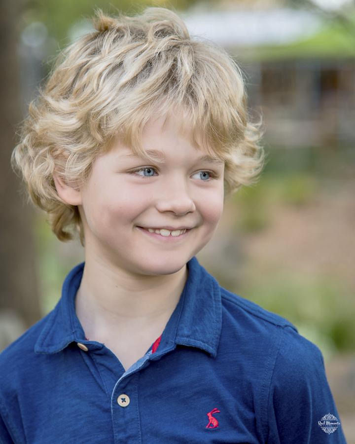 A portrait photo of a smiling boy