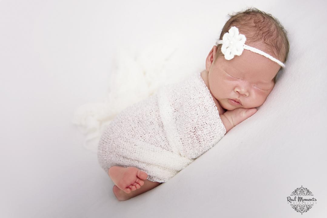 A newborn photo of a girl