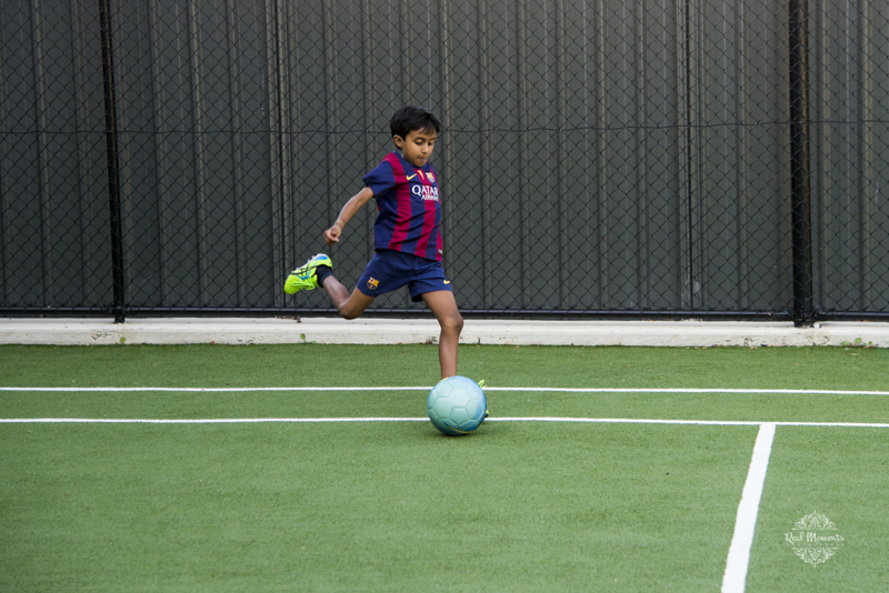 A photo of a boy playing football