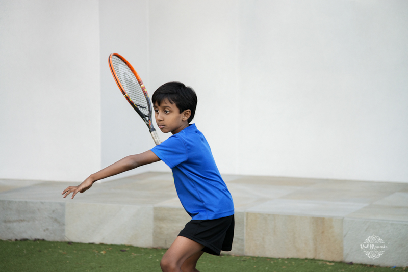 A photo of a boy playing tennis