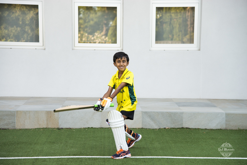 A photo of a boy playing cricket