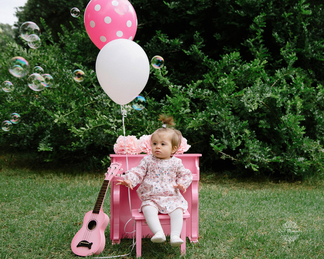 Adelaide family photography - baby photoshoot - baby sitting on a pink chair