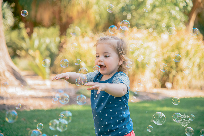 Adelaide professional photographer - sophie playing with bubbles in the botanic gardens