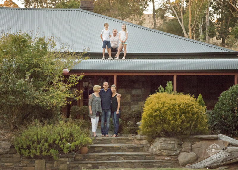 Adelaide family professional photography - family portrait with a background of their home