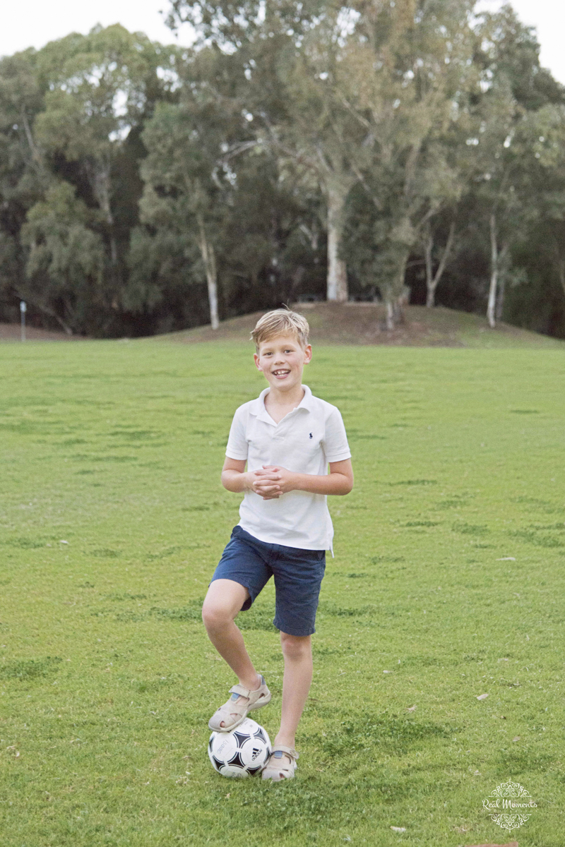 Adelaide family professional photography -  boy playing football