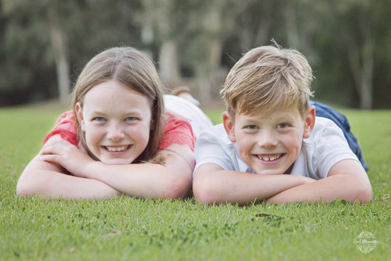 Adelaide family professional photography - two kids lying on grass