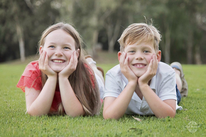 Adelaide family professional photography - siblings laying on the grass