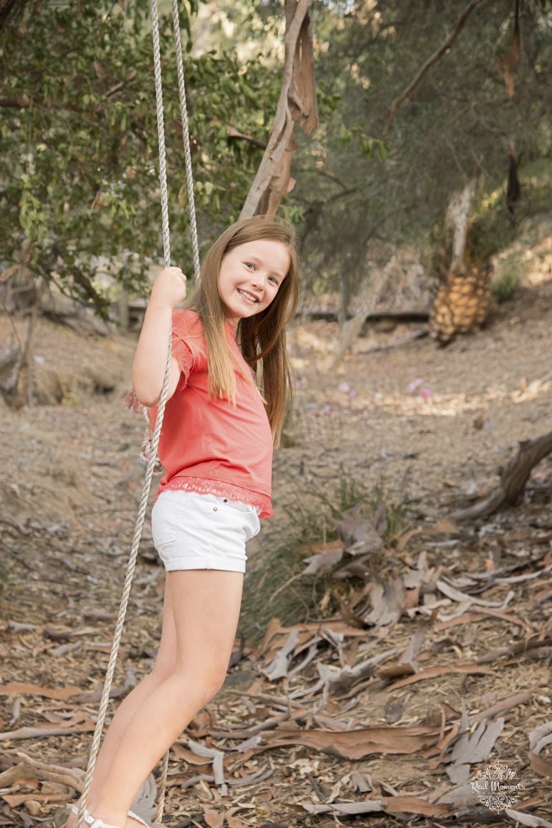 Adelaide family professional photography -  girl playing on a swing