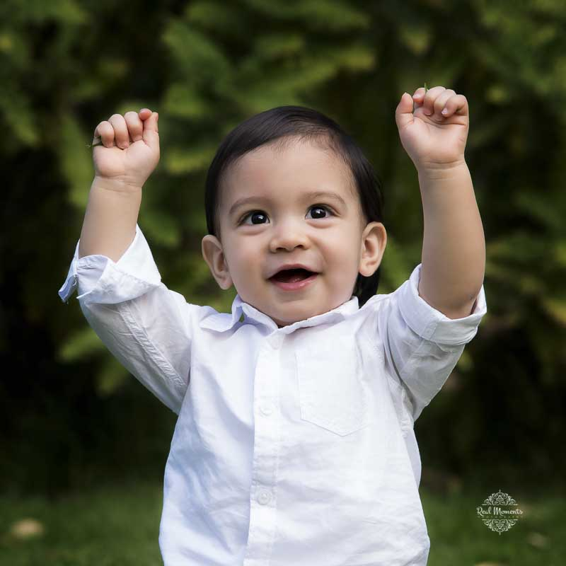 Full of beans! Adelaide family portrat photography - of a boy raising his hands