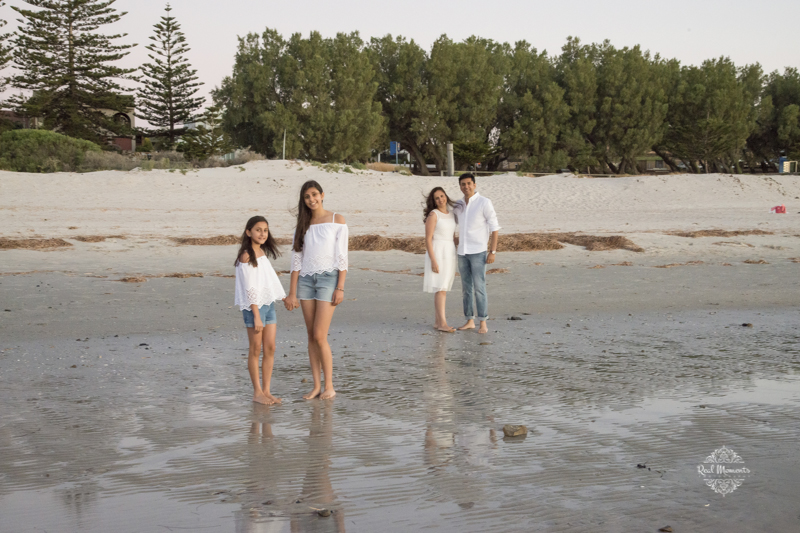 sunset serenity - family walking on a beach - AIPP certified photographer Adelaide
