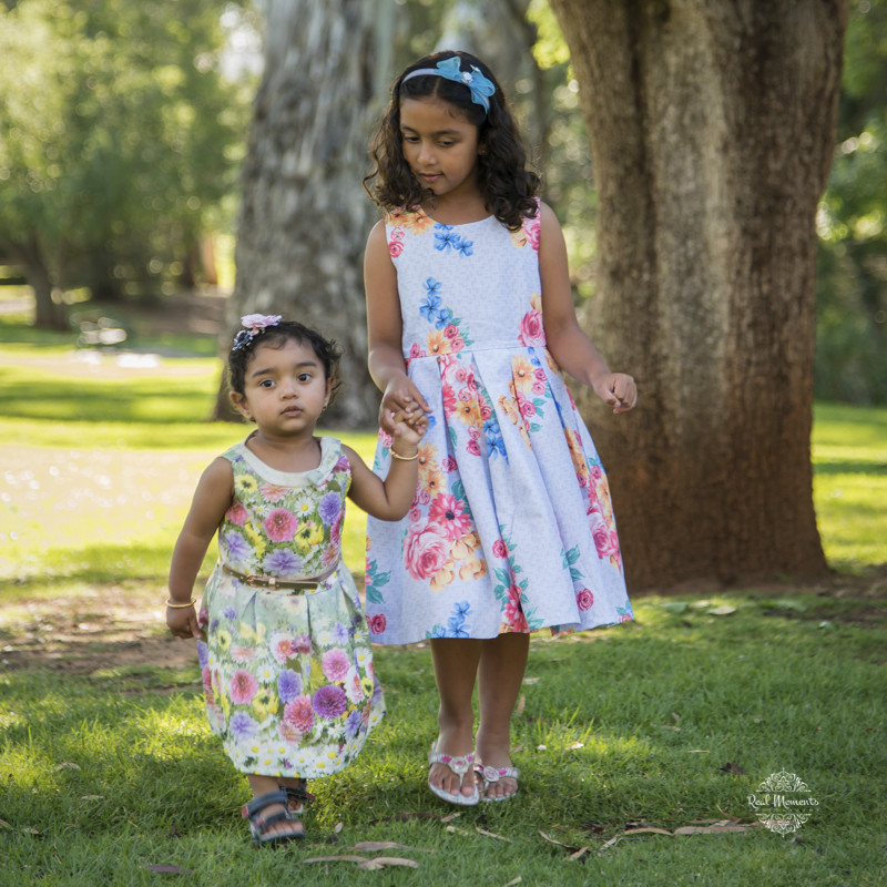 professional family photographer - girls walking in the garden
