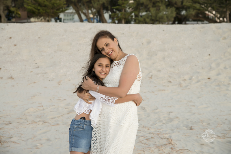 family portrait photography - photo of a mother hugging her daughter