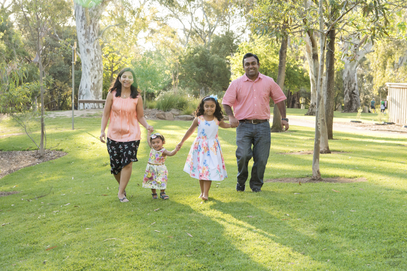 Adelaide professional family photographer - family walking in the garden