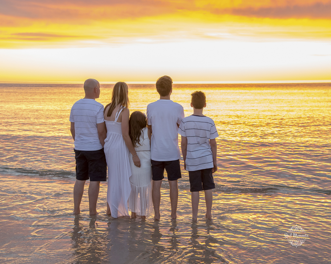 AIPP certified photography Adelaide - photo of a family standing on a beach during sunset