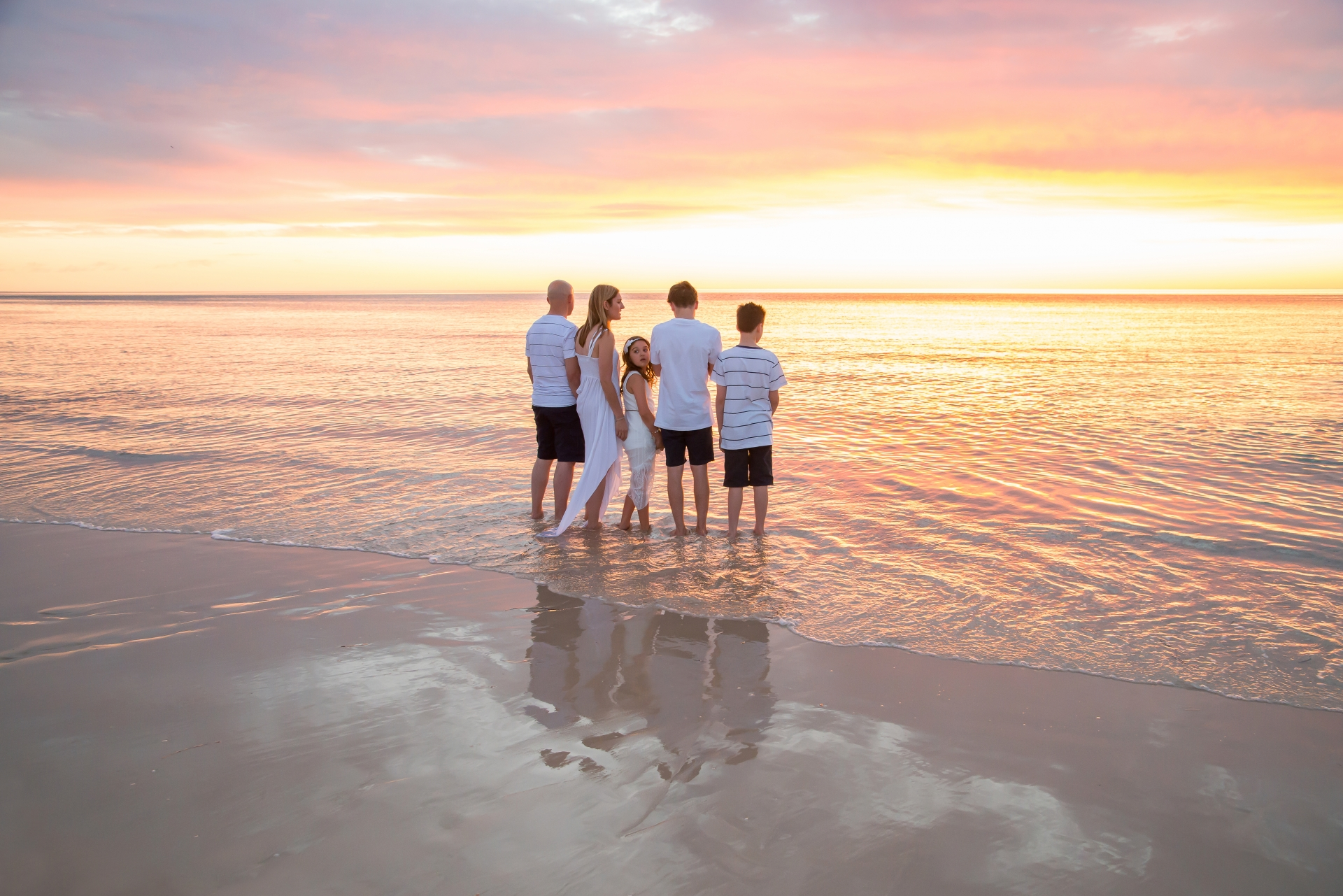 your investment - family photography at the beach with sunset