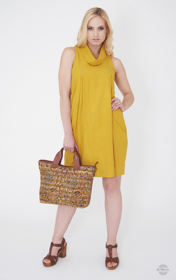 Business branding photography - A woman wearing Suchi's Couture yellow dress