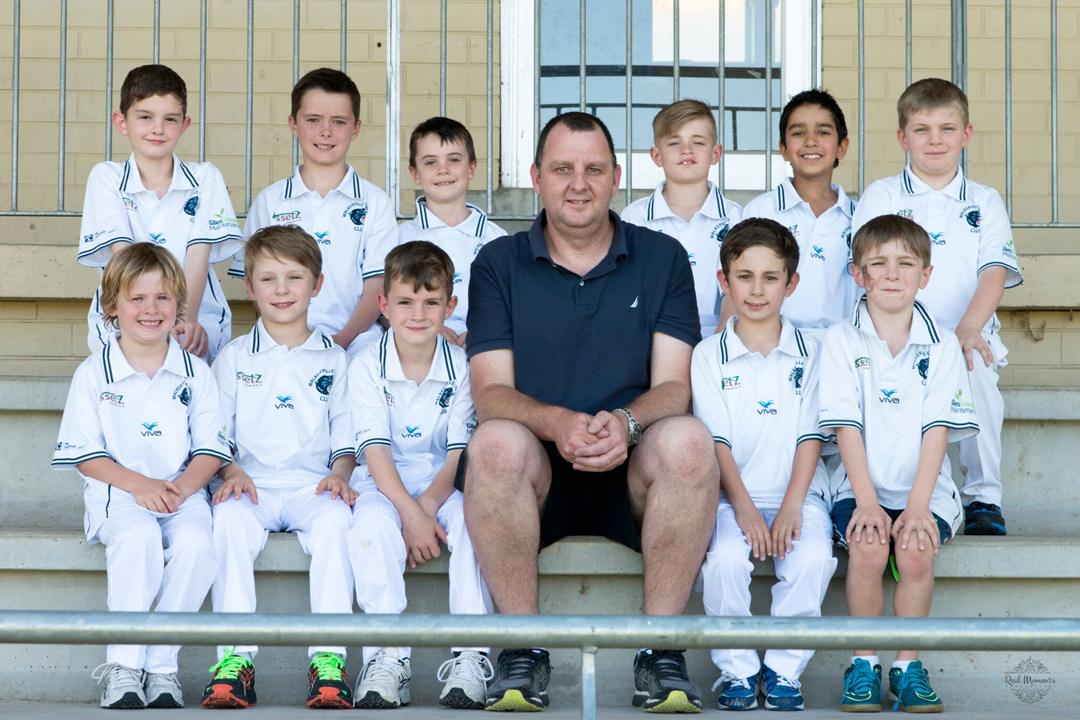 photo of Walkerville Cricket Club U9 - Panthers Team with their coach